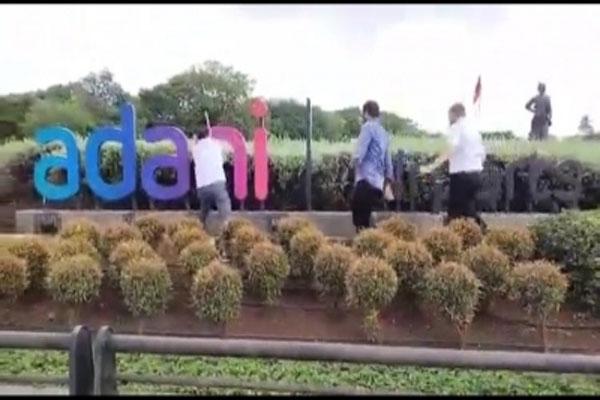 Shiv Sena workers tear down Adani hoarding at Mumbai airport - Mumbai News in Hindi