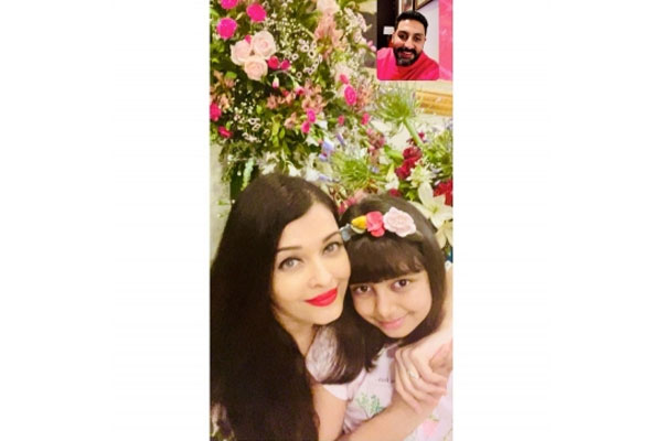 Aishwarya posts anniversary celebration pic, with Abhishek on video call - Bollywood News in Hindi