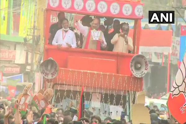 बंगाल विधानसभा चुनाव: गृह मंत्री अमित शाह ने कृष्णानगर उत्तर में किया रोड शो, देखे तस्वीरें