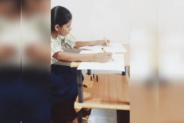 This Kerala girl draws pictures with her hands, feet and mouth - Weird Stories in Hindi