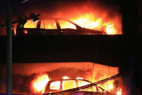 Parking garage fire destroys roughly 1400 cars in UK - World News in Hindi