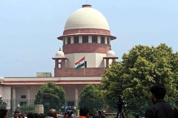 supreme court sc st act centre government review petition - News in Hindi