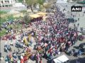 Huge gathering at Ghazipur near Delhi-Uttar Pradesh border as people wait to board special buses arranged by UP govt