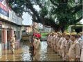 UP Police stood knee-deep in water to hoist the national flag