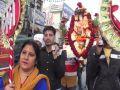Hundreds of devotees in Sai Baba sedan travel